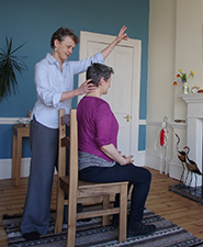 Julia, our Head of Training, working on seated posture with a student